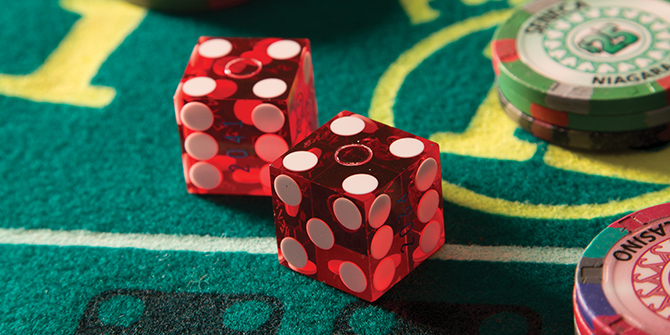 Photo of dice and chips on a table